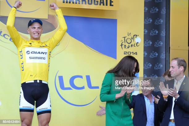 Giant Shimano's Marcel Kittel celebrates on stage watched by the Duke and Duchess of Cambridge after stage one of the Tour de France in Harrogate...