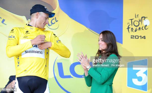 Giant Shimano's Marcel Kittel is presented with the leaders yellow jersey by the Duchess of Cambridge after stage one of the Tour de France in...