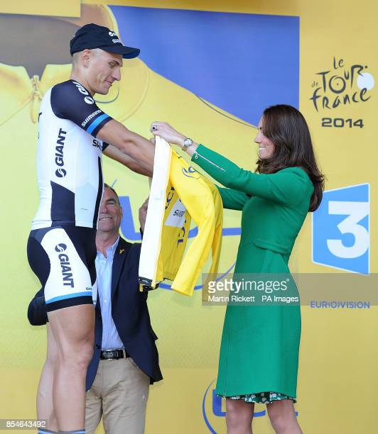 Giant Shimano's Marcel Kittel is prsented with the leaders yellow jersey by the Duchess of Cambridge after stage one of the Tour de France in...