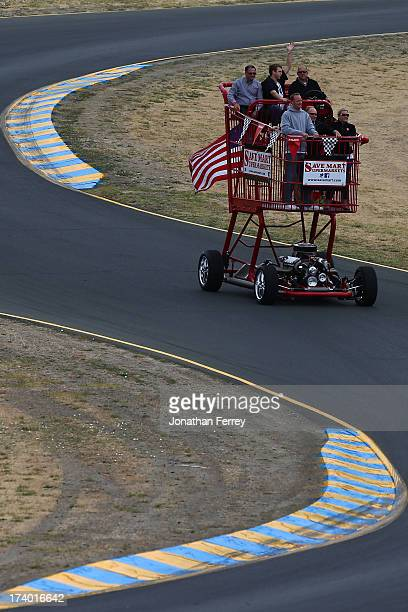 A giant shopping cart drives the track before the NASCAR Sprint Cup Series Toyota/Save Mart 350 at Sonoma Raceway on June 23 2013 in Sonoma California