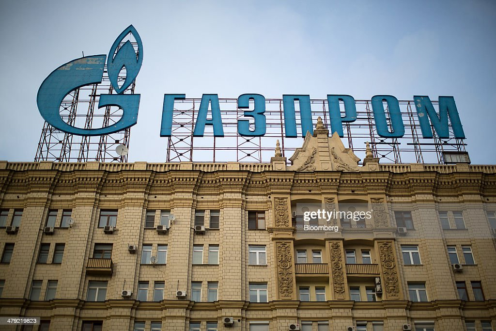 A giant sign for OAO Gazprom stands above a building in Moscow, Russia, on Sunday, March 16, 2014. The U.S. and the European Union warned Russia not to annex Crimea after a referendum in the southern Ukrainian region, setting the stage for sanctions on Russia in the worst diplomatic standoff since the Cold War. Photographer: Andrey Rudakov/Bloomberg via Getty Images