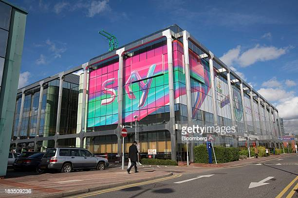 A giant Sky logo sits in the windows of a building at British Sky Broadcasting Group Plc's headquarters in London UK on Friday Oct 4 2013 BSkyB will...