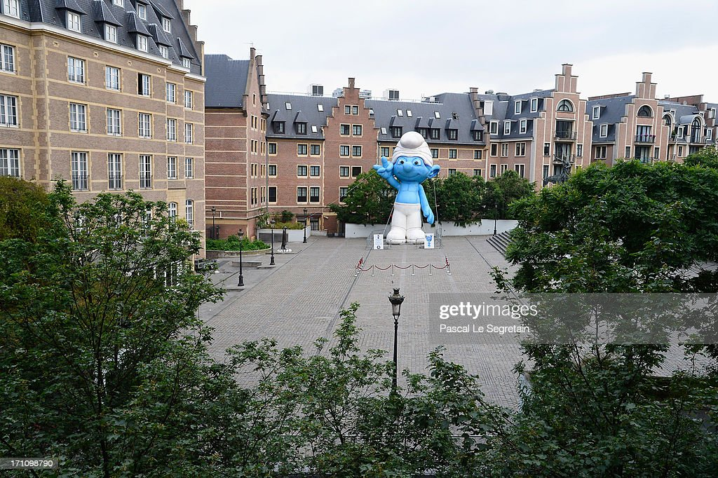 A giant Smurf character is displayed on Place d'Espagne during a ceremony as part of Global Smurfs Day celebrations on June 22, 2013 in Brussels, Belgium.