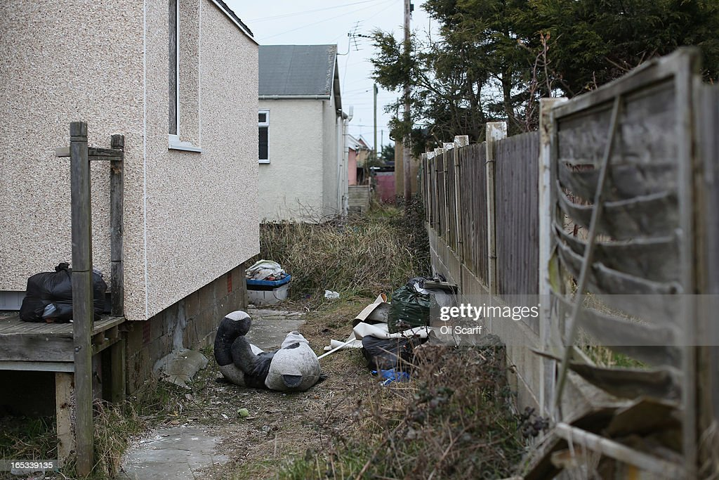 A giant soft toy panda is discarded in front of dilapidated properties in the seaside town of East Jaywick, the most deprived place in England, on April 3, 2013 in Jaywick, England. The Government's 2011 Indices of Multiple Deprivation' measure ranks Jaywick as the most deprived of all 32,482 small wards in England and Wales. The area also has the greatest number of young people not in employment, education or training; one third of 16 to 24 year-olds claim Jobseeker's Allowance, compared to the national average of 6 per cent. Changes to the benefits and tax system which came into force on April 1, 2013 have included a cut in housing benefit payments for working-age social housing tenants whose property is deemed larger than they need and council tax support payments now being administered locally.