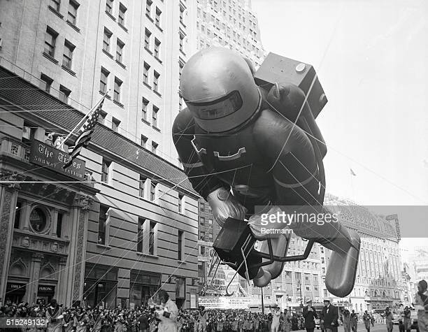 A giant spaceman balloon looms over the crowd watching the Macy's Thanksgiving Day Parade in New York City The heliumfilled balloon was one of the...