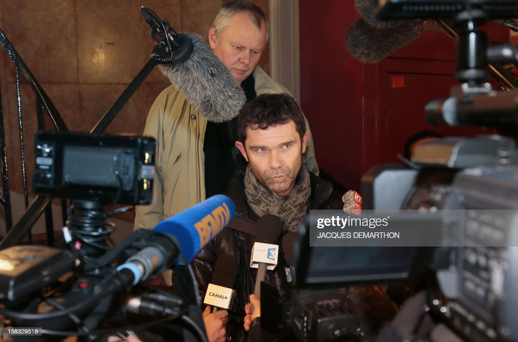 Giant steel ArcelorMittal CFDT union representative Jean-Marc Vecrin, speaks to journalists on December 13, 2012, in Paris, after an extraordinary CCE (Group Central Committee). French President Francois Hollande said last week he would personally guarantee that steel multinational ArcelorMittal stood by a commitment to keep jobs at a plant threatened with closure as angry trade unionists threatened strike action.