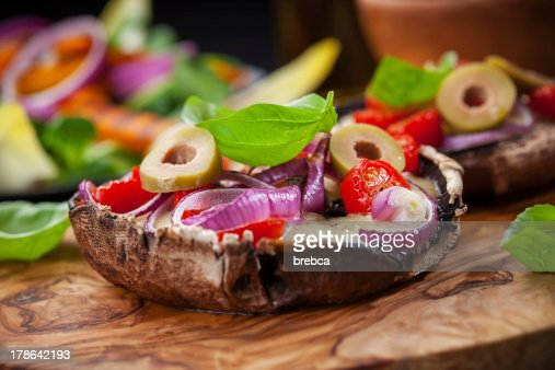 Giant stuffed Portobello mushrooms : Stock Photo
