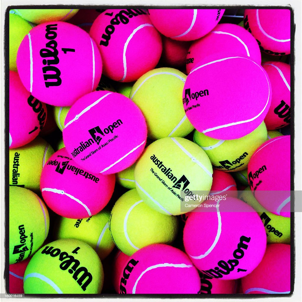 Giant tennis balls are displayed in the Australian Open merchandise store during day eight of the 2013 Australian Open at Melbourne Park on January 21, 2013 in Melbourne, Australia.