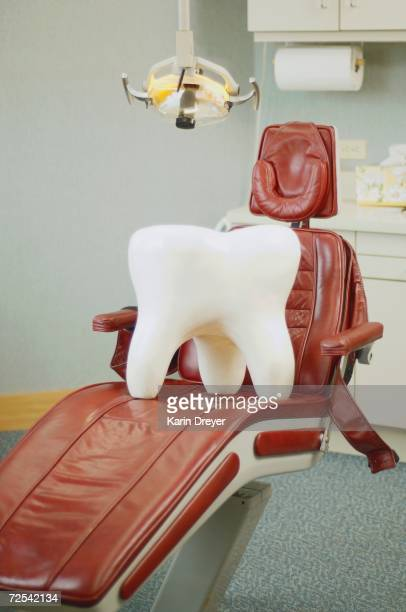 Giant tooth sitting on dentist's chair