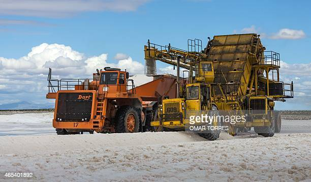 Giant trucks collect salt to be washed at the Exportadora de Sal company plant in Guerrero Negro Baja California Sur state Mexico on March 03 2015...