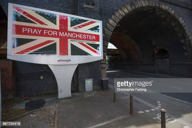 A giant TV advertisement screen next to a railway bridge displays 'Pray For Manchester' after last nights terrorist attack May 23 2017 in Manchester...