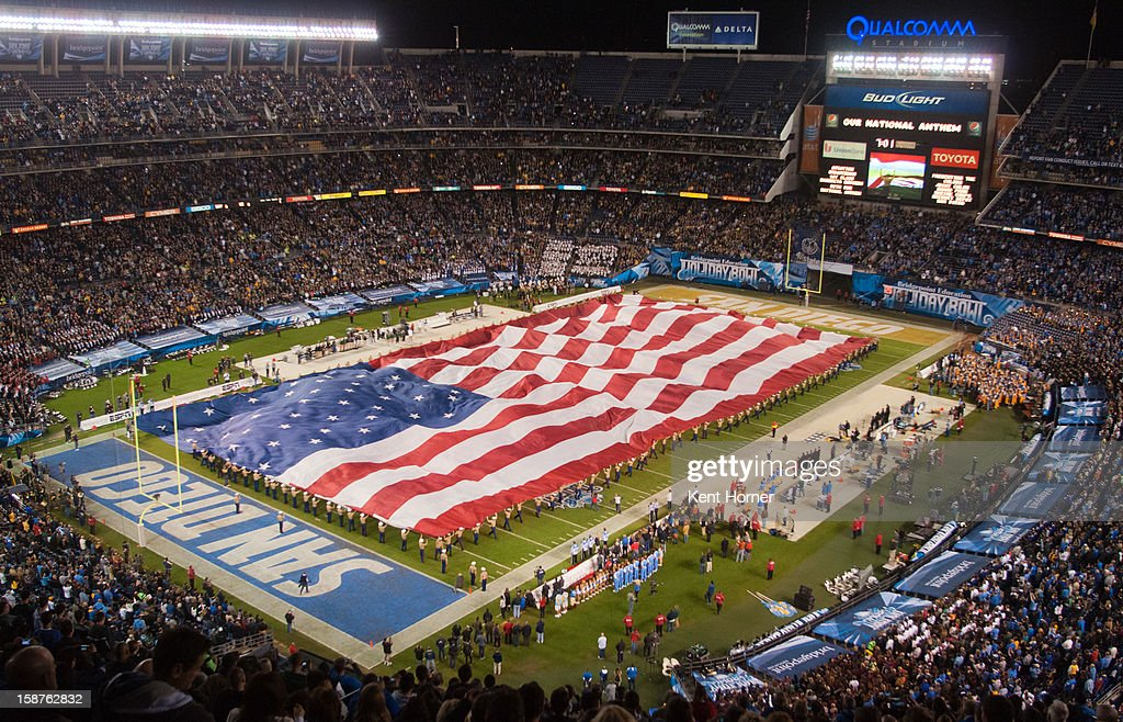 A giant United States flag is unfurled on the field during pregame festivities prior to the game between the UCLA Bruins and the Baylor Bears in the Bridgepoint Education Holiday Bowl at Qualcomm Stadium on December 27, 2012 in San Diego, California.