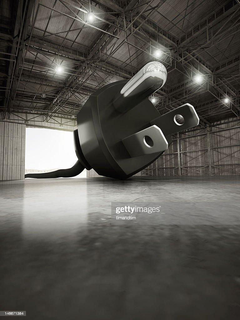 Giant US plug in a hangar