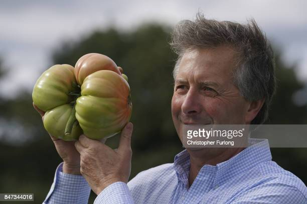 Giant vegetable grower Gareth Griffin from Leeds from poses with his giant award winning tomato that weighed in at 25kg at the Harrogate Autumn...