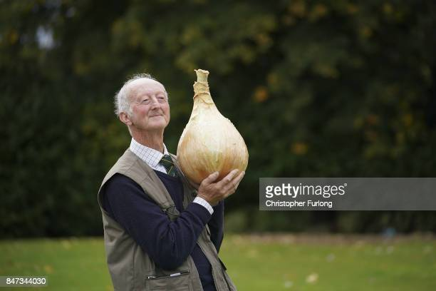 Giant vegetable grower Peter Glazebrook from Newark poses with his giant award winning onion that weighed in at 665kg at the Harrogate Autumn Flower...