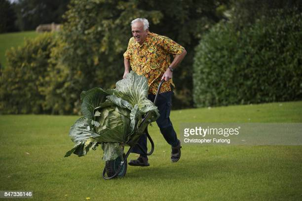 Giant vegetable grower Peter Ian Neale from Newport poses with his giant award winning cabbage that weighed in at 254kg at the Harrogate Autumn...