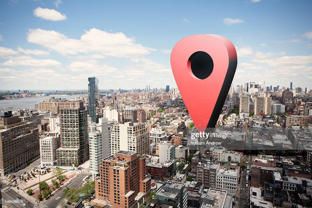 Giant virtual map pin on city landscape : Stock Photo