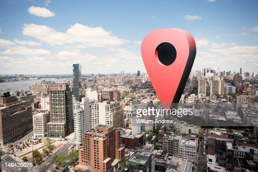 Giant virtual map pin on city landscape