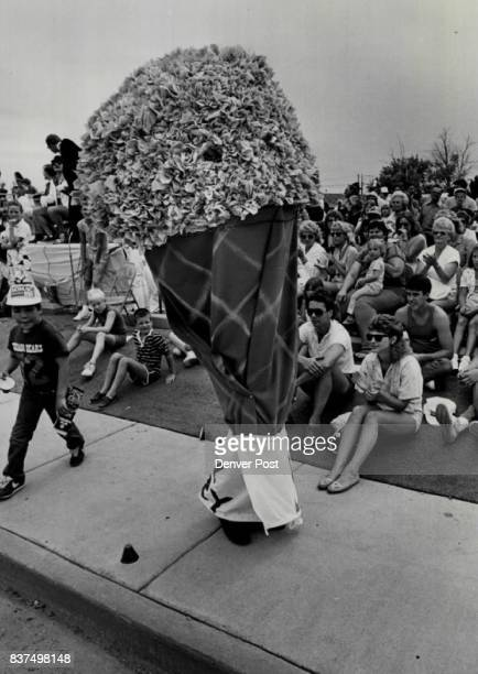 A giant walking icecream cone received warm applause during a sidewalk parade Saturday afternoon in Arvada The 'float' was sponsored by the Country...