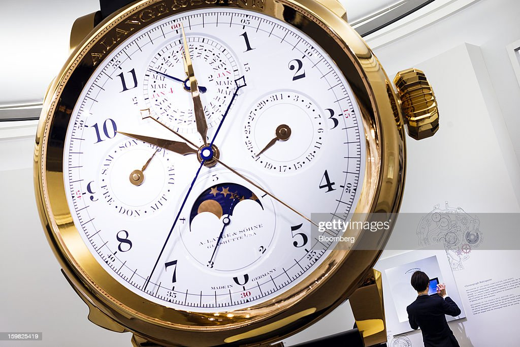 A giant watch sits on display at the A. Lange & Soehne, a unit of Cie. Financiere Richemont SA, booth during the first day of the Salon International de la Haute Horlogerie (SIHH) watch fair in Geneva, Switzerland, on Monday, Jan. 21, 2013. The Swiss watch industry slowed in the second half of 2012 as sales of timepieces and jewelry in Hong Kong, the biggest market for Swiss watchmakers, declined in August and October. Photographer: Valentin Flauraud/Bloomberg via Getty Images