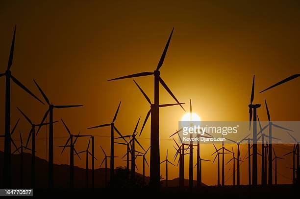 Giant wind turbines are powered by strong winds during sunset on March 27 2013 in Palm Springs California According to reports California continues...