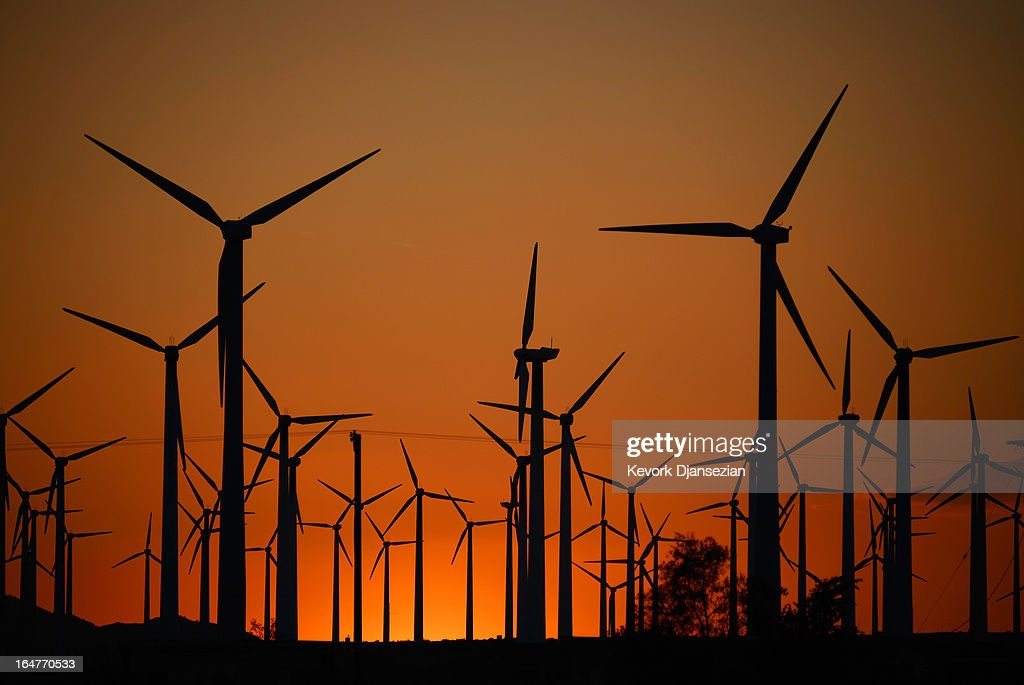 Giant wind turbines are powered by strong winds during sunset on March 27, 2013 in Palm Springs, California. According to reports, California continues to lead the nation in green technology and has the lowest greenhouse gas emissions per capita, even with a growing economy and population.