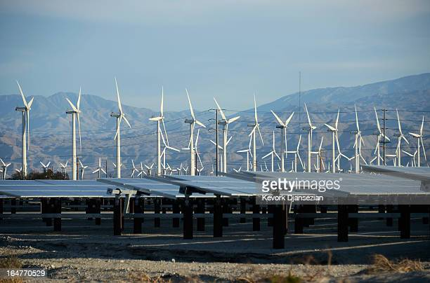 Giant wind turbines are powered by strong winds in front of solar panels on March 27 2013 in Palm Springs California According to reports California...