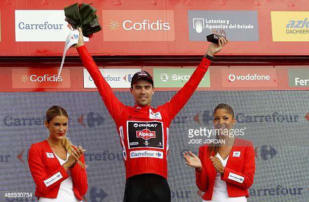 GiantAlpecin's Dutch cyclist Tom Dumuolin celebrates on the podium with the Red jersey after winning the Ninth stage of the 2015 Vuelta Espana...