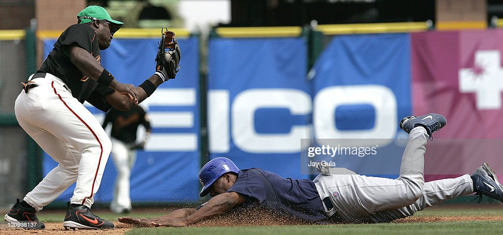 Giants 2B Ray Durham lays the tag down on an attempted steal by Cubs OF Jacque Jones in Cactus League action at Scottsdale Stadium in Scottsdale...