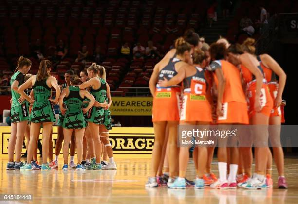 Giants and Fever players huddle after the round two Super Netball match between the Giants and the West Coast Fever at Qudos Bank Arena on February...