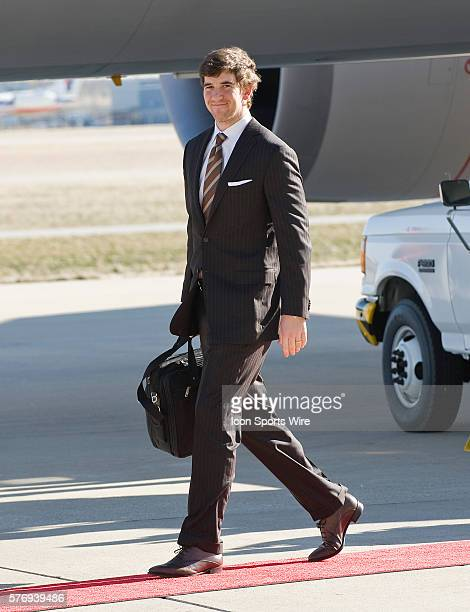 NY Giants arrive at Indianapolis Int Airport on a United Airlines charter from Newark Airport Giants quaterback Eli Manning smiles as he walks off...