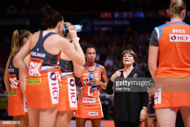 Giants coach Julie Fitzgerald talks to her players during a time out during the round 14 Super Netball match between the Giants and the Lightning at...