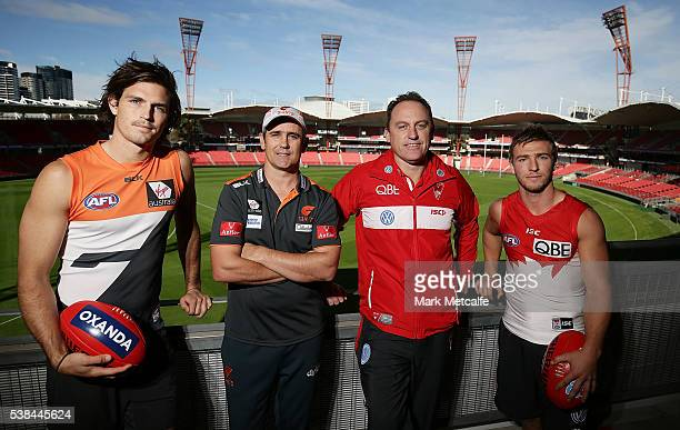 Giants coach Leon Cameron Phil Davis of the Giants Swans coach John Longmire and Kieren Jack of the Swans pose during an AFL press conference at...
