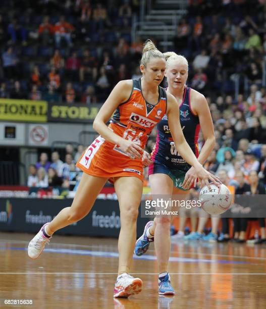 Giants goal attack Jo Harten evades Vixens goal defence Jo Weston during the round 12 Super Netball match between the Giants and the Vixens at AIS on...
