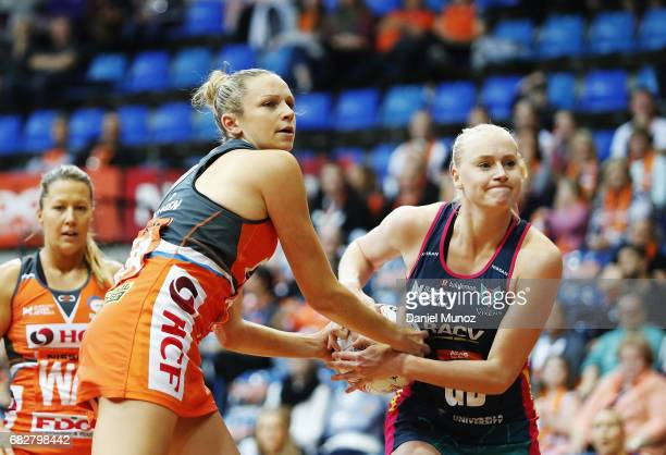 Giants goal attack Jo Harten fights for a ball against Vixens goal defence Jo Weston during the round 12 Super Netball match between the Giants and...