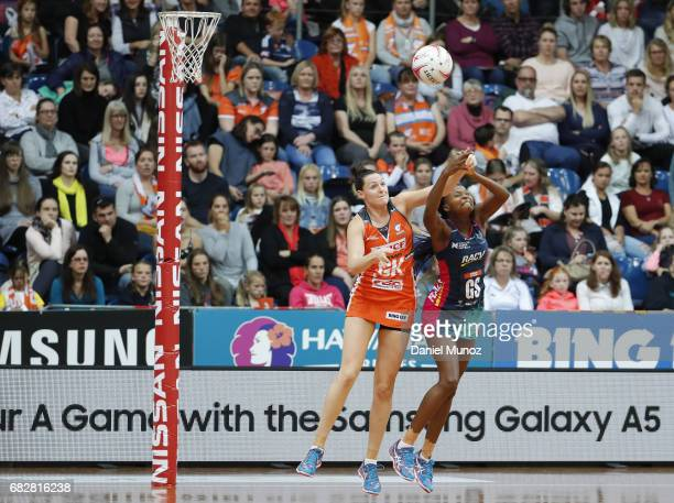 Giants goal keeper Sam Poolman fights for the ball against Vixens goal shooter Mwai Kumwenda during the round 12 Super Netball match between the...