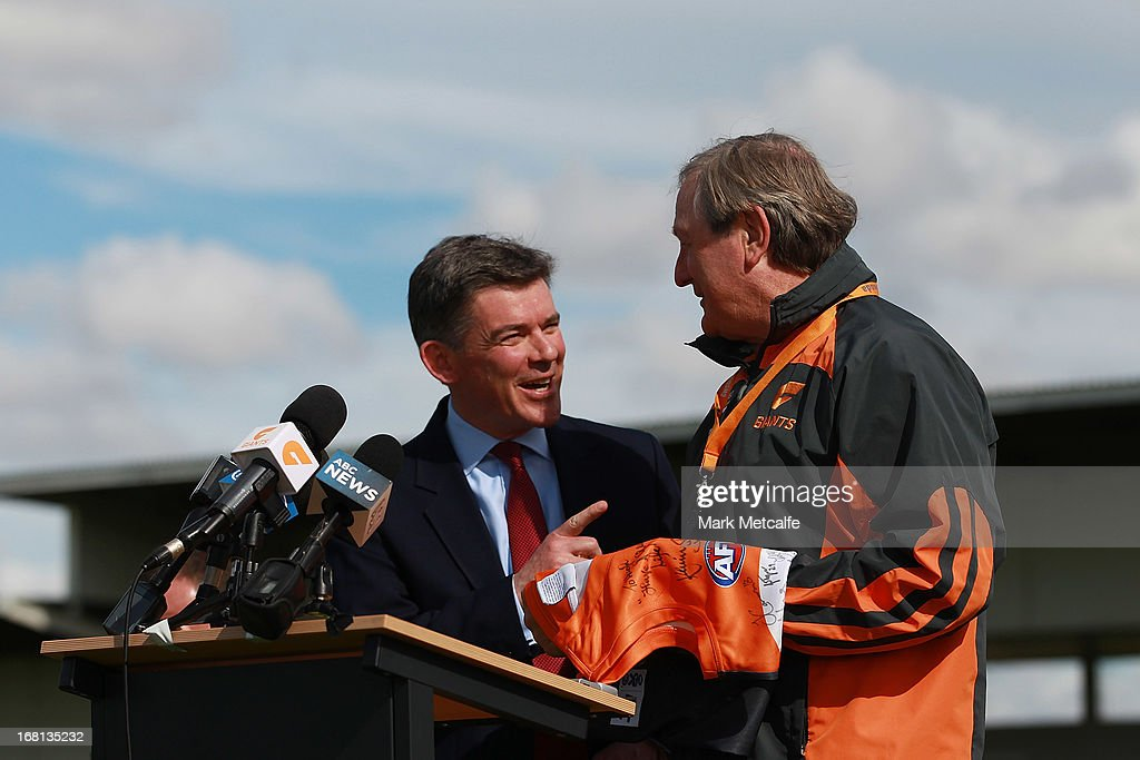 Giants Head Coach <a gi-track='captionPersonalityLinkClicked' href=/galleries/search?phrase=Kevin+Sheedy&family=editorial&specificpeople=204695 ng-click='$event.stopPropagation()'>Kevin Sheedy</a> presents a jersey to UK Sports Minister Hugh Robertson during a GWS Giants AFL media session at Sydney Olympic Park Sports Centre on May 6, 2013 in Sydney, Australia.