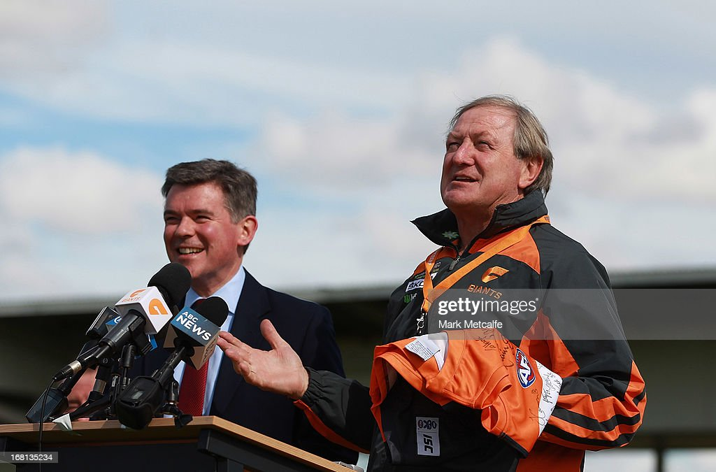 Giants Head Coach Kevin Sheedy presents a jersey to UK Sports Minister Hugh Robertson during a GWS Giants AFL media session at Sydney Olympic Park Sports Centre on May 6, 2013 in Sydney, Australia.