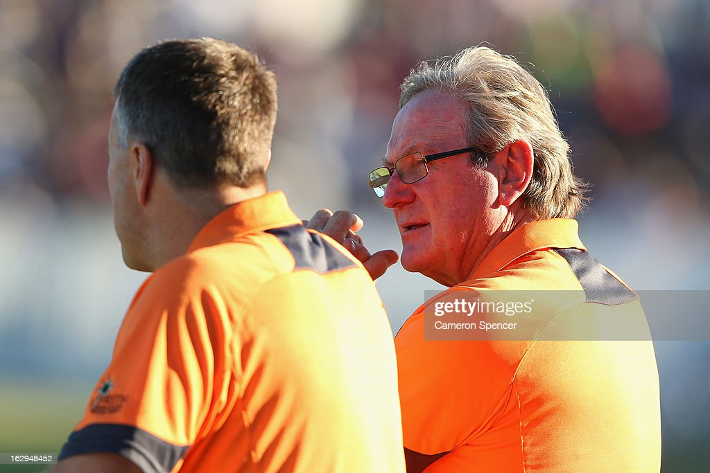 Giants head coach Kevin Sheedy (R) watches his players warm up during the round two AFL NAB Cup match between the Greater Western Sydney Giants and the Brisbane Lions at the Robertson Oval in Wagga Wagga, Australia.