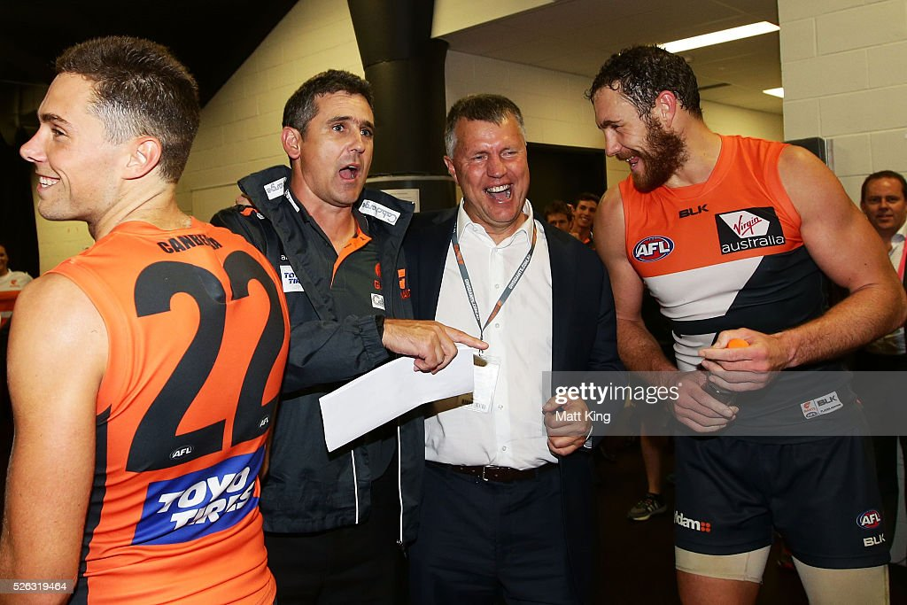 Giants head coach Leon Cameron (L) speaks to former GWS Giants football manager Graeme Allan (R) before the Giants sing their club song after victory in the round six AFL match between the Greater Western Sydney Giants and the Hawthorn Hawks at Spotless Stadium on April 30, 2016 in Sydney, Australia.