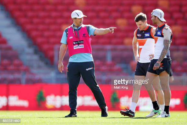 Giants head coach Leon Cameron talks to Heath Shaw and Nathan Wilson during a Greater Western Sydney Giants AFL training session at Spotless Stadium...