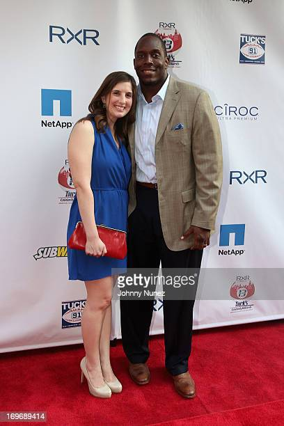 Giants Kevin Boothe and guest attend the NY Giants Justin Tuck's 5th Annual Celebrity Billiards Tournament on May 30 2013 in New York City