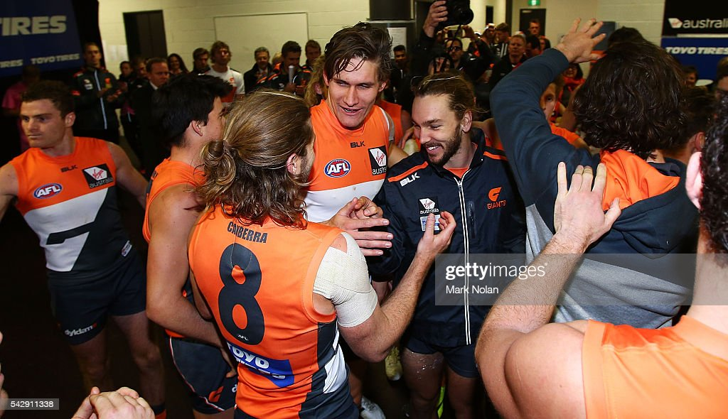 Giants players celebrate after winning the round 14 AFL match between the Greater Western Sydney Giants and the Carlton Blues at Spotless Stadium on June 25, 2016 in Sydney, Australia.
