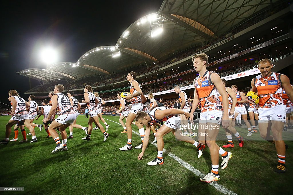 Giants players run onto the field before the start of play during the round 10 AFL match between the Adelaide Crows and the Greater Western Sydney Giants at Adelaide Oval on May 28, 2016 in Adelaide, Australia.