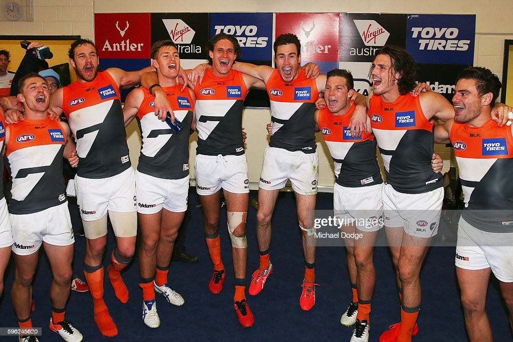 Giants players sing the club song after winning during the round 23 AFL match between the North Melbourne Kangaroos and the Greater Western Sydney...