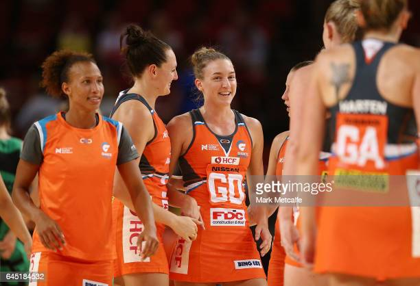 Giants players smile after victory in the round two Super Netball match between the Giants and the West Coast Fever at Qudos Bank Arena on February...
