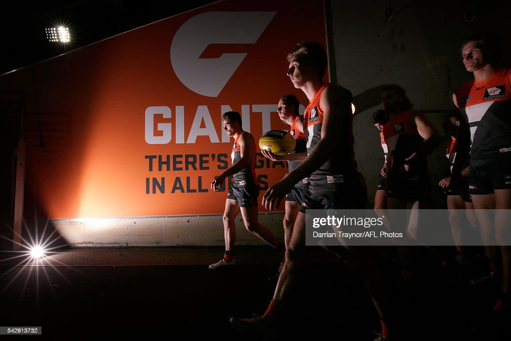 GWS Giants players walk onto the ground after the half time break during the round 14 AFL match between the Greater Western Sydney Giants and the Carlton Blues at Spotless Stadium on June 25, 2016 in Sydney, Australia.