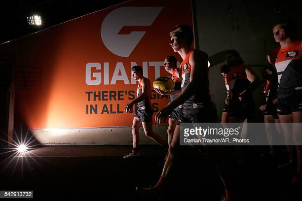 Giants players walk onto the ground after the half time break during the round 14 AFL match between the Greater Western Sydney Giants and the Carlton...