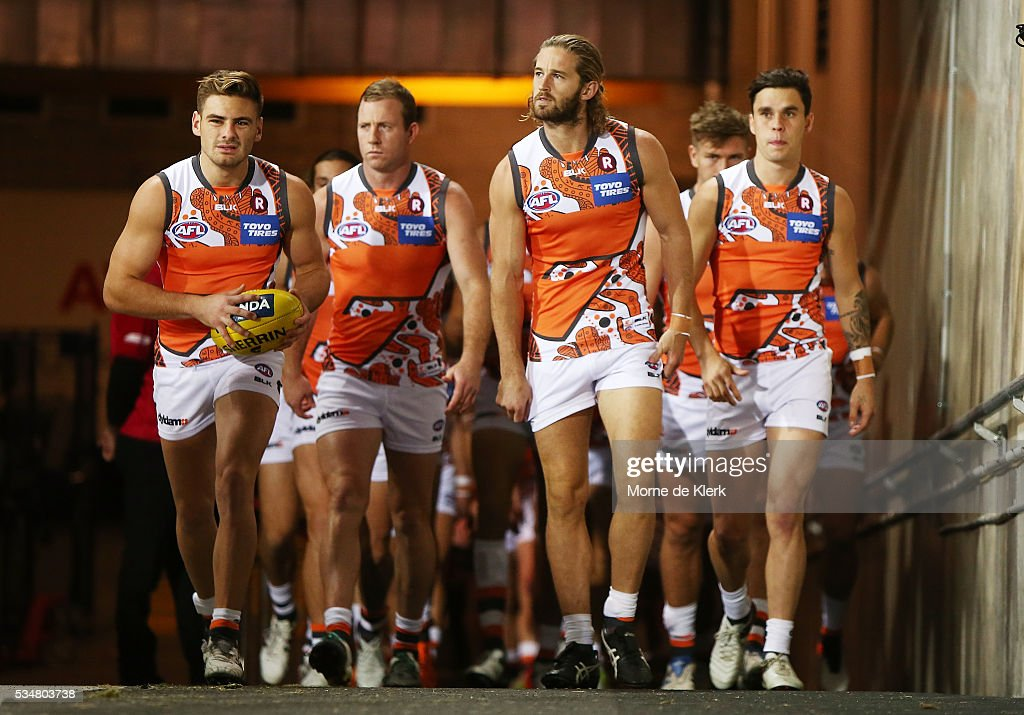 Giants players walk up the race to take the field before the round 10 AFL match between the Adelaide Crows and the Greater Western Sydney Giants at Adelaide Oval on May 28, 2016 in Adelaide, Australia.
