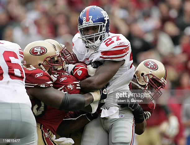Giants rookie runningback Brandon Jacobs gets held up by the 49ers defensive line as the New York Giants defeated the San Francisco 49ers by a score...